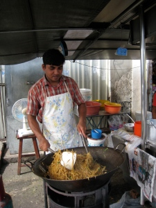 A street hawker cooking up his specialty