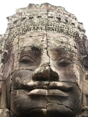 one of the 216 mysterious stone faces in the Bayon