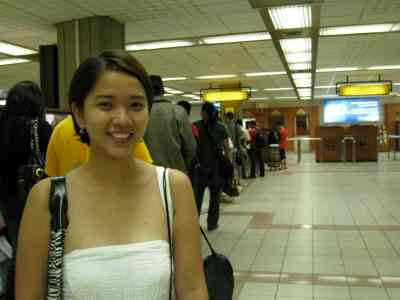 smiling despite the long queue at the immigration counter